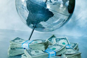 Globe and pile of money
