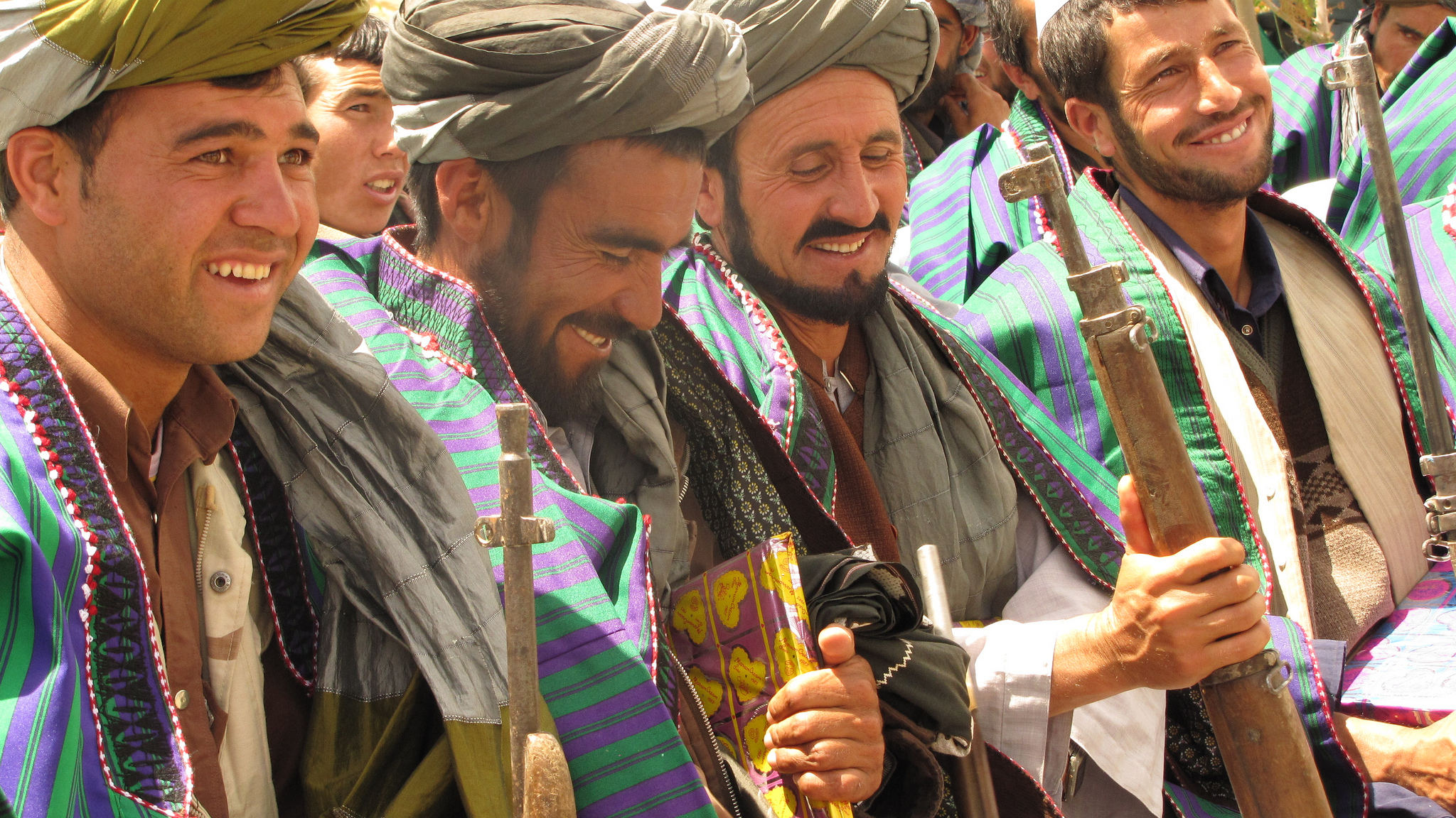 GHŌR, Afghanistan (May 28, 2012) – Former Taliban fighters hold rifles as they prepare to hand them over to the Government of the Islamic Republic of Afghanistan during a reintegration ceremony at the provincial governor's compound.